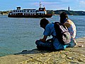 The couple and the Lisbon - Cacilhas ferryboat (19559585491).jpg
