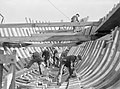 The hull of a minesweeping trawler being constructed using traditional techniques in a shipyard on the east coast of Britain, October 1942. A13288.jpg