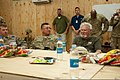 Thriller author Clive Cussler, foreground right, speaks with U.S. Soldiers during a USO tour called Operation Thriller II at Forward Operating Base Gamberi, Afghanistan, Nov. 5, 2011 111105-A-LI672-029.jpg