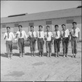 Topaz, Utah. Members of the drum and bugle corp, formerly a boy scout troop at Los Angeles, pose fo . . . - NARA - 538693.tif