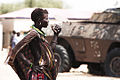 Toposa woman with tank.jpg