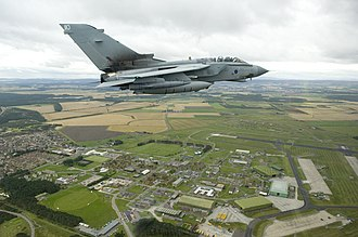 RAF Lossiemouth - A Tornado GR4 of 617 Squadron (Dambusters) over RAF Lossiemouth.