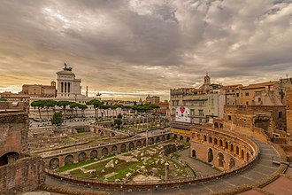 The Imperial fora belong to a series of monumental fora (public squares) constructed in Rome by the emperors. Also seen in the image is Trajan's Market. Trajansmarkte Forum.jpg