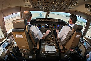 Tradesman - Commercial pilots land a Boeing 777.