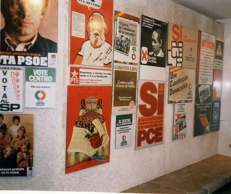 Political posters from the 1970s on a simulated street wall in an exhibition celebrating 20 years of the Spanish Constitution of 1978.