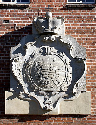 Schleswig-Holstein-Sonderburg-Plön - The coat of arms of Plön is encircled by the collar of the Order of the Elephant. The crown and orb represent royal Danish descent (relief from the gable panel on Traventhal Castle)