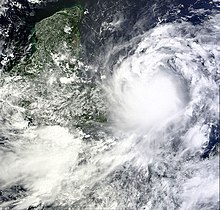 A satellite image depicting a well-developed tropical cyclone prior to striking Central America.
