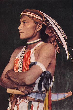 Austronesian peoples - Colorized photograph of a Tsou warrior wearing traditional clothing, pre-World War II