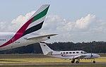 Turbo Prop passing Emirates-01+ (520631198).jpg