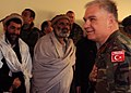 Turkish Brigadier General greets Afghan elders at a shura.jpg