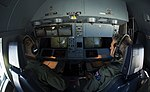 Two RAAF airmen at a KC-30s refueling controls.jpg
