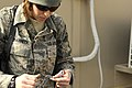 U.S. Air Force Staff Sgt. Emily Johanneck prepares the wiring for a solar powered light at Bagram Airfield, Afghanistan, Feb. 23, 2010 100223-F-PI632-121.jpg