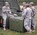 U.S. Army Capt. Frank Brown, communication officer with Headquarters and Headquarters Detachment, 213th Regional Support Group, Pennsylvania Army National Guard, speaks with Soldiers about setting up 130605-Z-XV361-226.jpg
