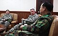 U.S. Army Lt. Gen. John Johnson, center, the commanding general of the Eighth U.S. Army (EUSA), and Col. Mark Calvo, left, the deputy chief of staff of EUSA, meet with South Korean army Gen. Lee Chul-hyee 110309-A-AP548-013.jpg