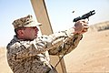 U.S. Marine Corps Staff Sgt. Shawn Minosky, with Regional Command Southwest, fires an M9 pistol Oct. 3, 2013, during a weapons marksmanship course at Camp Leatherneck, Afghanistan 131003-M-DE426-001.jpg