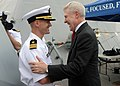 U.S. Navy Cmdr. Timothy Wilke, left, the commanding officer of the littoral combat ship USS Freedom (LCS 1), talks with Secretary of the Navy Ray Mabus aboard the ship at Singapore May 11, 2013 130511-N-PD773-018.jpg