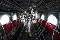 U.S. Navy Damage Controlman 3rd Class Carson Seitz searches the interior of a CH-46 Sea Knight helicopter while training to rescue injured aircrewmen during flight deck drills aboard the amphibious transport 130510-N-DR144-416.jpg