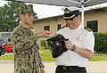 U.S. Navy Mass Communication Specialist 3rd Class Michael Scicilone, left, discusses underwater photography equipment to a Chilean navy captain, with the Chilean Naval War College, during a tour of Navy 120808-N-ZQ794-125.jpg