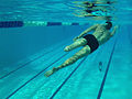 U.S. Navy retired Parachute Rigger 3rd Class Michael Johnson works out with the freestyle stroke during Wounded Warriors swim practice at Scott Pool 121114-F-ZB240-0745.jpg