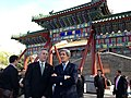 U.S. Secretary of State John Kerry, accompanied by longtime Chinese translator James Brown, stand in front of the South Gate to Beihai Park and look at Bai Ta, or the White Pagoda, at Beihai Park in Beijing, China.jpg