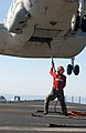 US Navy 021116-N-7265L-010 An Aviation Ordnanceman attempts to attach straps to an CH-46D Sea Knight from the Gunbearers of Helicopter Support Squadron One One (HC-11).jpg