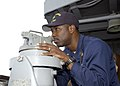 US Navy 030221-N-4649C-003 Chief Yeoman Duane Gowins from Melbourne, Fla., determines other ships' bearings using a telescopic alidade.jpg