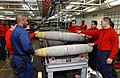 US Navy 030327-N-1328C-520 Aviation Ordnancemen assemble bombs aboard USS Theodore Roosevelt (CVN 71).jpg