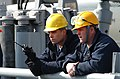 US Navy 040310-N-7217H-013 Sailors assigned to USS Guardian (MCM 5) stand by as the ship is moored at a dry dock in Sasebo, Japan, for a one-month maintenance and repair schedule.jpg