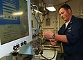 US Navy 040701-N-2788L-024 Aviation Electronics Technician 3rd Class Jason Short, from Cincinnati, Ohio, calibrates a Consolidated Automated Support System (CASS) bench in an intermediate maintenance shop aboard USS Ronald Reag.jpg