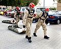 US Navy 041123-N-9563N-507 Members assigned to the Naval Support Activity (NSA) Bahrain Emergency Response Team, lead contaminated victims of a simulated Chemical, Biological, and Radiological attack to be treated.jpg