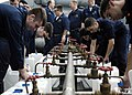 US Navy 050104-N-4166B-134 Sailor's assigned to the Reactor Department and Repair Division aboard USS Abraham Lincoln (CVN 72) fill jugs with purified water from a Potable Water Manifold.jpg