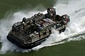 US Navy 050110-N-7586B-036 A Landing Craft Air Cushion (LCAC) vehicle, assigned to USS Bonhomme Richard (LHD 6) and Expeditionary Strike Group Five (ESG-5), en route to deliver much needed materials and supplies to the citizens.jpg