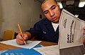 US Navy 050223-N-5821P-054 Seaman Chanthorn Peou of San Diego, Calif., takes his Scholastic Aptitude Test (SAT) aboard the conventionally powered aircraft carrier USS Kitty Hawk (CV 63).jpg