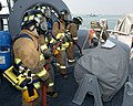 US Navy 050228-N-9563N-004 Members of Naval Support Activity (NSA) Bahrain's Emergency Response Team (ERT) send-down a fire hose to fight a simulated fire aboard the mine countermeasure ship USS Cardinal (MHC 60) during exercis.jpg