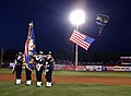 US Navy 050315-N-3271W-006 A color guard from the Navy and Marine Corps Reserve Center, Phoenix, Ariz., post the colors as a U.S. Navy Leap Frogs parachute team member enters the stadium during a Cactus League spring training b.jpg