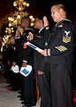 US Navy 050427-N-9197B-001 Storekeeper 1st Class John Macalma takes the oath of allegiance during a naturalization ceremony held at the U.S. Embassy in Rome.jpg