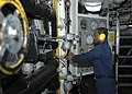 US Navy 060607-N-0938S-043 Engineman 3rd Class Terrance Wilson makes an adjustment to the ^1 Main Propulsion Boiler in the Forward Main Machine Room (MMR) aboard the amphibious assault ship USS Saipan (LHA 2).jpg
