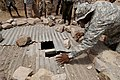 US Navy 060701-N-9500T-028 U.S. Army Staff Sgt. Marvin Steward, assigned to Combined Joint Task Force-Horn of Africa, inspects a well, which will be used used as a water source for the village clinic.jpg