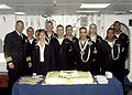 US Navy 061013-N-3666S-011 USS Wasp (LHD 1) Commanding Officer Capt. Michael Hawley, U.S. Ambassador to Iceland Carol van Voorst, and Sailors from the multipurpose amphibious assault ship stand in front of the cake for the U.S.jpg