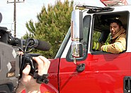 US Navy 070314-N-9132D-001 Aviation Boatswain's Mate (Handling) 2nd Class Henry Campos, a firefighter assigned to Naval Station Rota Fire Dept., tapes a fire safety commercial for the American Forces Network