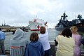US Navy 070615-N-8933S-138 Friends and family members wave goodbye as Military Sealift Command (MSC) hospital ship USNS Comfort (T-AH 20) gets underway to take part in a multi-month humanitarian assistance deployment to the U.S.jpg