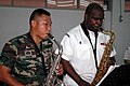 US Navy 070711-N-7783B-002 Musician 3rd Class Lloyd Whitty and Pvt. Halmi of the Royal Malaysian Army Band play the saxophone during a joint practice concert at the Kuantan Naval Base.jpg