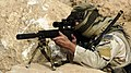 US Navy 070907-N-6477M-113 A U.S. Special Forces Soldier conducts rehearsal, training and pre-operation conformation on the MK 12 sniper rifle.jpg