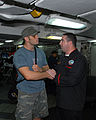 US Navy 080911-N-4995K-001 Ultimate Fighting Championship fighter Rich Franklin shakes hands with Culinary Specialist 2nd Class Jimmy McMaster after eating dinner with the crew aboard USS Ronald Reagan (CVN 76).jpg
