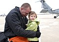 US Navy 081202-N-8933S-054 Aviation Structural Mechanic 2nd Class Richard Evans greets his daughter during a homecoming ceremony.jpg
