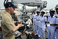 US Navy 100314-N-8335D-371 Ensign Kevin Lewman shows minesweeping gear to midshipmen from the Bangladesh Naval Academy.jpg