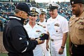 US Navy 100318-N-3271W-142 Crewmembers of USS Florida (SSGN 728) present a ball cap to New York Yankees Manager Joe Girardi.jpg