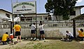 US Navy 100722-N-9643W-280 Sailors and Airmen embarked aboard High Speed Vessel Swift (HSV 2) paint the gate of the Ministry of AmerIndian Affairs Amerindian Residence during a community service event.jpg