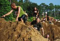 US Navy 100918-N-7084M-405 Participants in the 15th Annual Seabee Volkslauf Mud Run make their way over a obstacle in the five-mile course at Naval.jpg