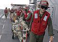 US Navy 100920-N-5538K-042 Marines and Sailors transport GBU-12 Paveway II laser-guided bombs across the flight deck of the forward-deployed amphib.jpg
